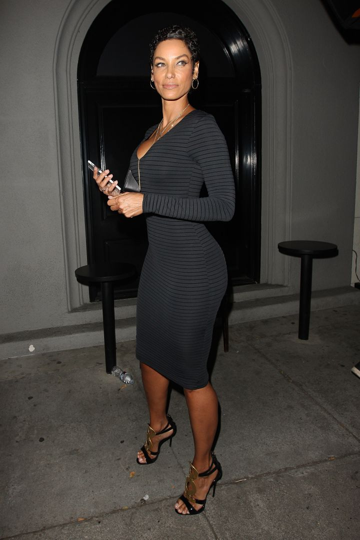 Nicole Murphy kills all the competition in a skin-tight dress outside of Craig's restaurant.