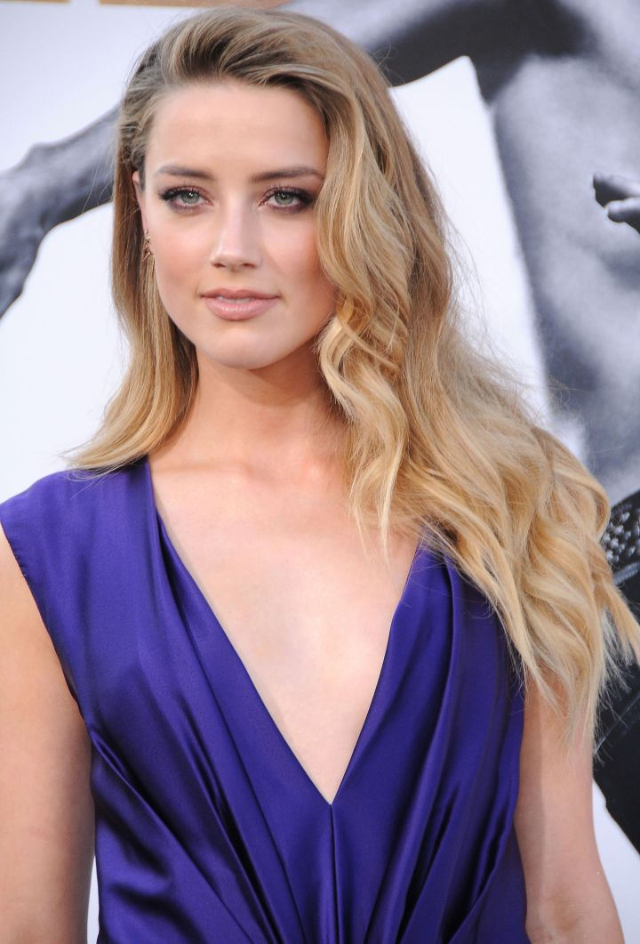Amber Heard hit the carpet looking stunning in purple.