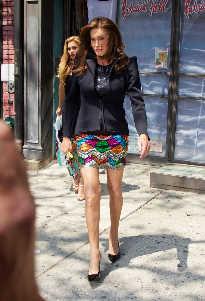 Caitlyn Jenner shows off her style in a colorful mini-skirt and dark jacket.
