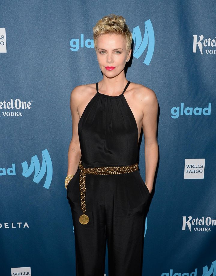 Charlize Theron was born in South Africa and her first language is Afrikaans. After relocating to the U.S., she practiced ballet until a leg injury ended her dancing career. She has since won an Academy Award for her acting, and only became a U.S. citizen in 2008 after an extensive process that involves interviews and tests about the American government.