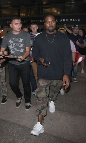Kanye West is mobbed by autograph collectors as he arrives in Los Angeles
