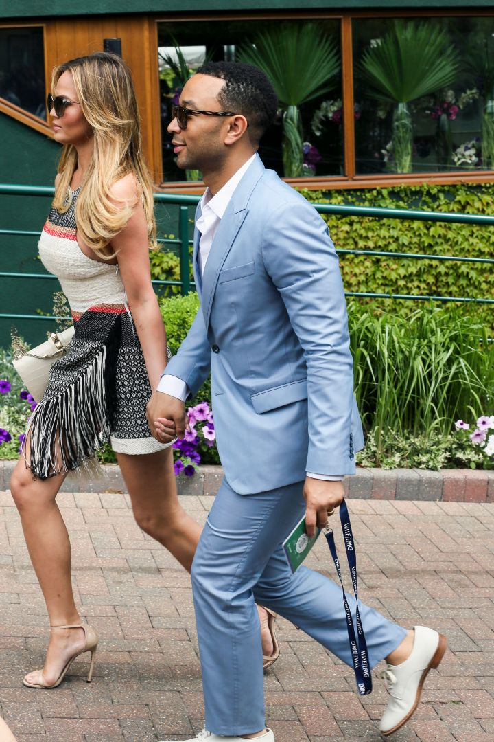 Chrissy Teigen and John Legend were spotted holding hands while arriving at Wimbledon.