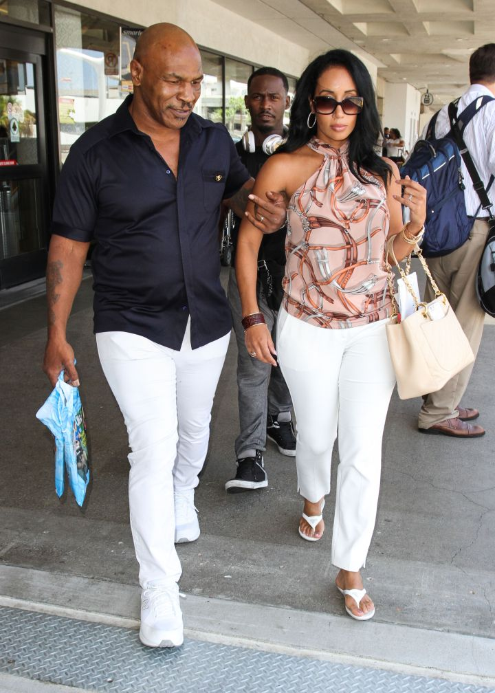Mike Tyson and wife Lakiha Spicer were seen at LAX Airport looking cool for the summer.