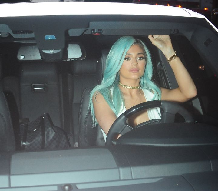 Kylie Jenner exits her hair event in West Hollywood, California sporting new pale blue locks.