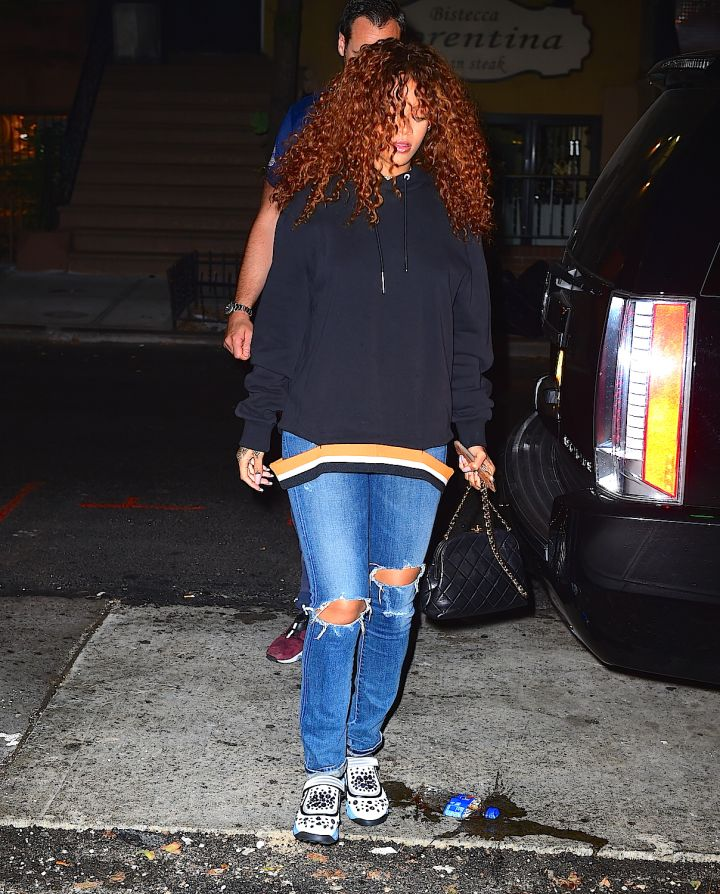 Rihanna hits the studio with a new curly 'do.