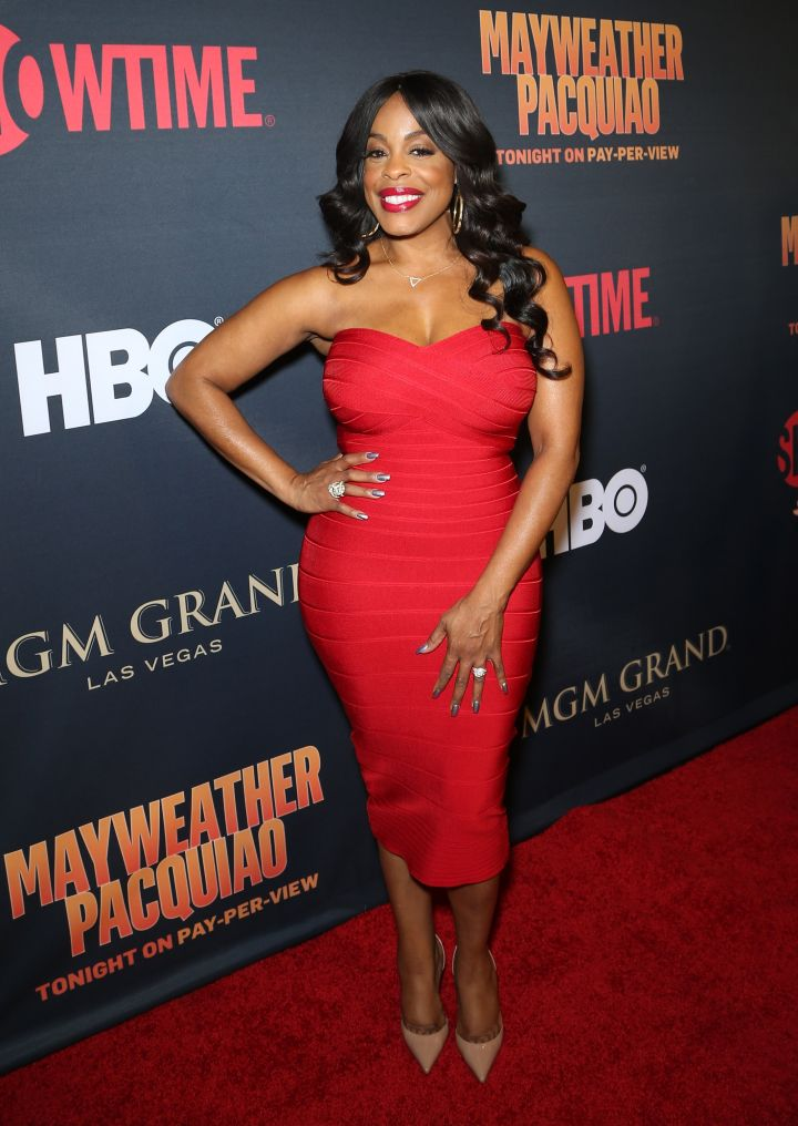 Niecy Nash resonates with beauty in a red dress.