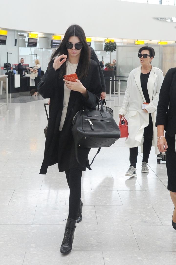 Kendall Jenner doesn't want to be bothered in LAX as Kris Jenner follows close behind.