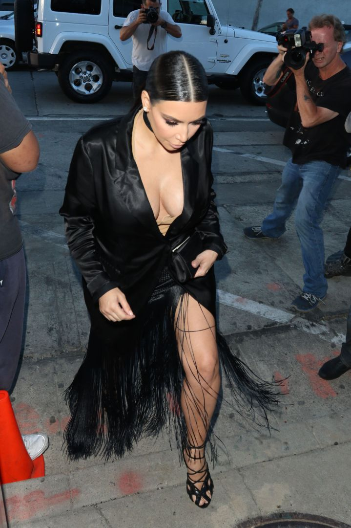 Kim Kardashian flashes a little leg while at dinner at Craig's Restaurant in West Hollywood, CA.