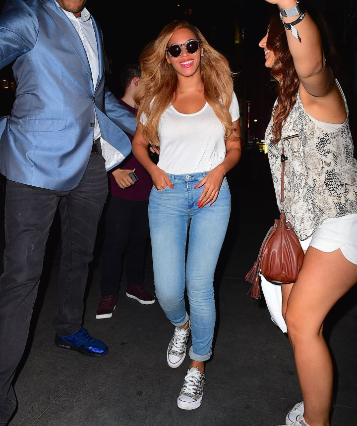 Blue jean cutie Beyonce takes a moving selfie with a fan in New York.