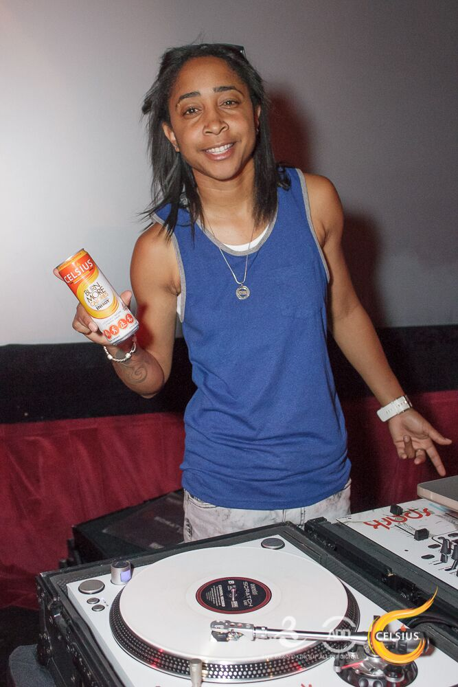 DJ Spark cools down with the night's drink of choice: Celsius.