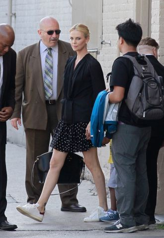Charlize Theron exits the back of the 'Jimmy Kimmel Live' studios in Los Angeles.
