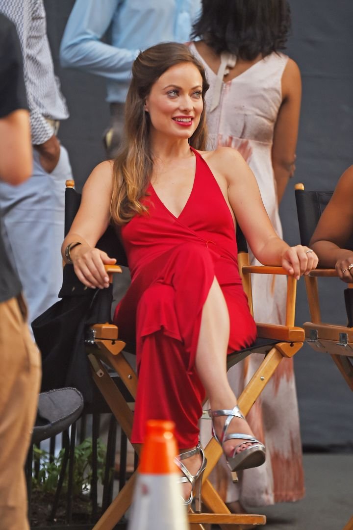 """Olivia Wilde pops in red while on the set of HBO's """"Rock 'N' Roll project."""""""