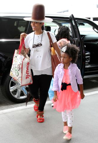 Singer Erykah Badu and her family are spotted at LAX Airport in Los Angeles, Ca