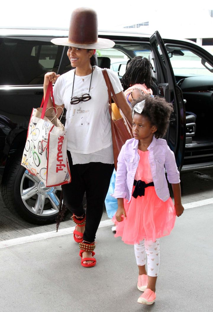 Erykah Badu keeps a smile on her face while traveling with her family in L.A.