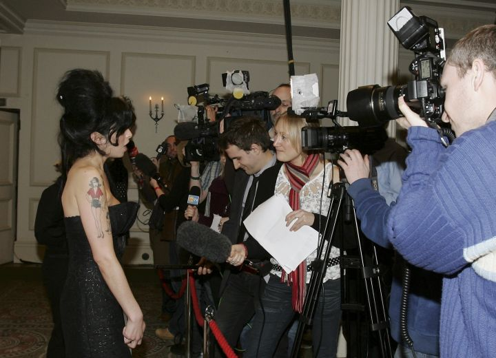 Amy after receiving the Pop Award for 'Back to Black' at the South Bank Show Awards 2007.