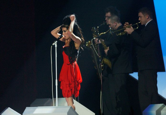 Amy performs on stage at the BRIT Awards 2007