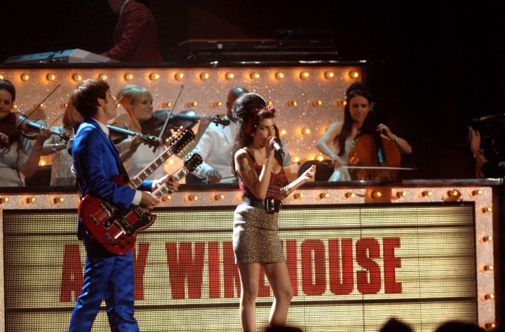 Amy Winehouse and Mark Ronson perform at the Brit Awards 2008