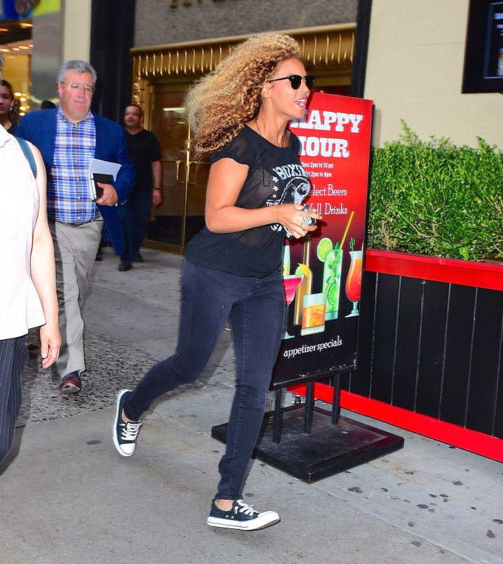 Stand down, Bey Hive. It's just Beyonce running through the tourists in Times Square, attempting to go unseen. She dashed past a large Happy Hour sign, with her hair flowing in the breeze.