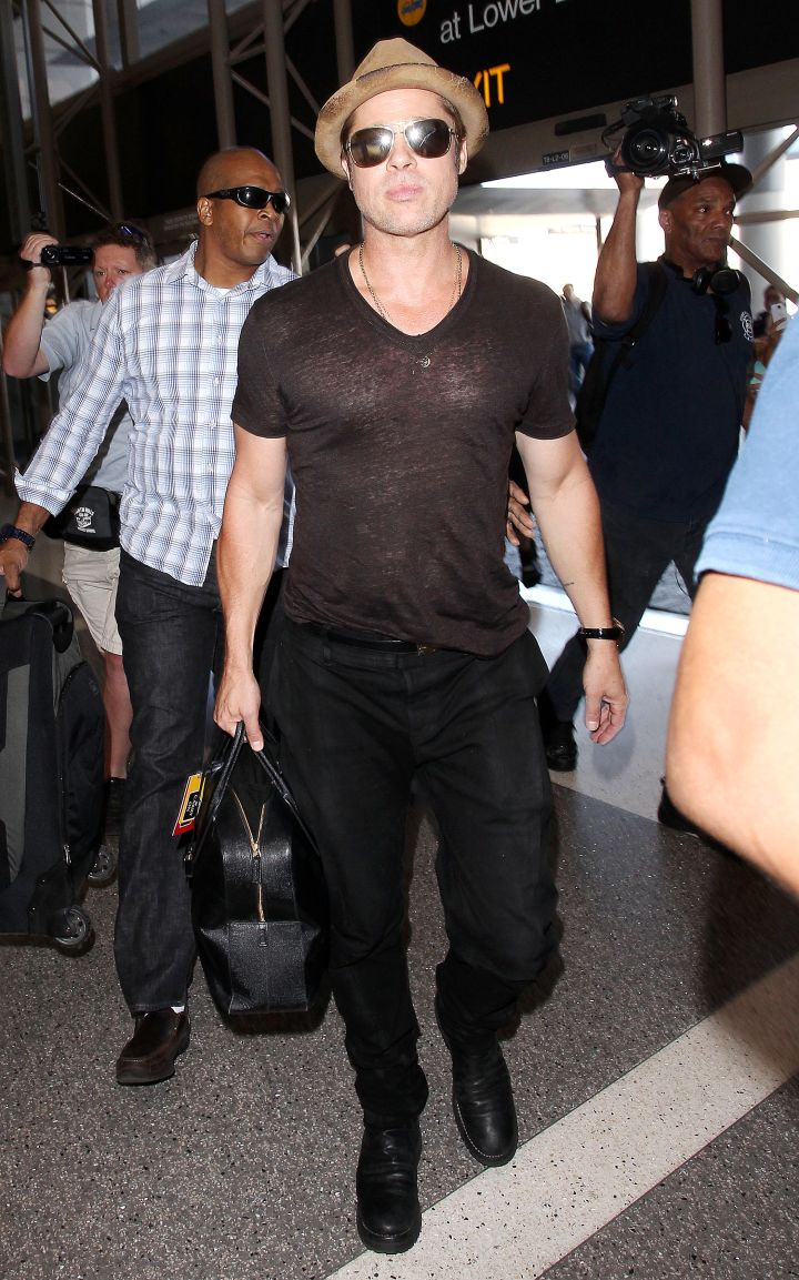 Brad Pitt rocked a super fitted shirt while arriving at Los Angeles International Airport.