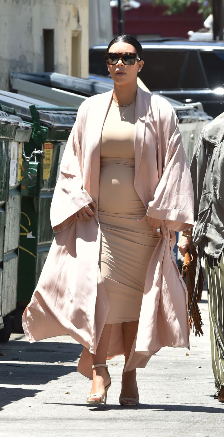 Kim K showed off her ever growing belly as she headed to the Pantages Theater in Hollywood.