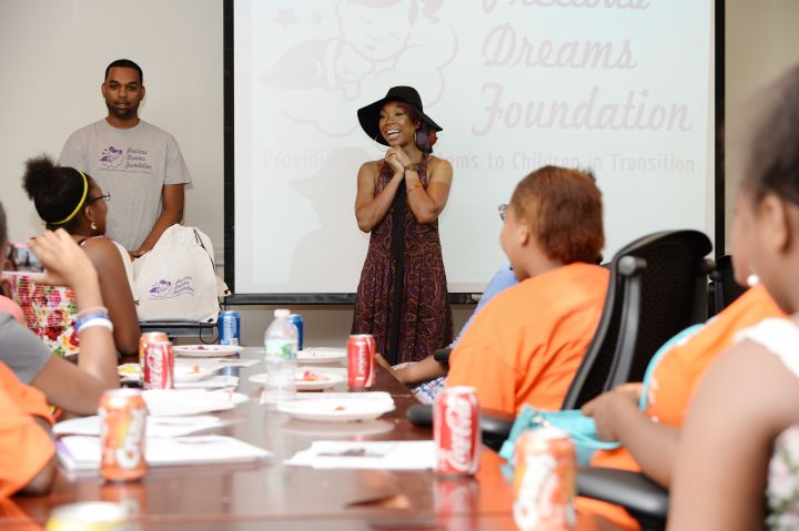 There wasn't a dry eye in the room, as Brandy shared her very personal struggles and stressed the importance of staying and thinking positive while giving back with the help of the Precious Dreams Foundation.