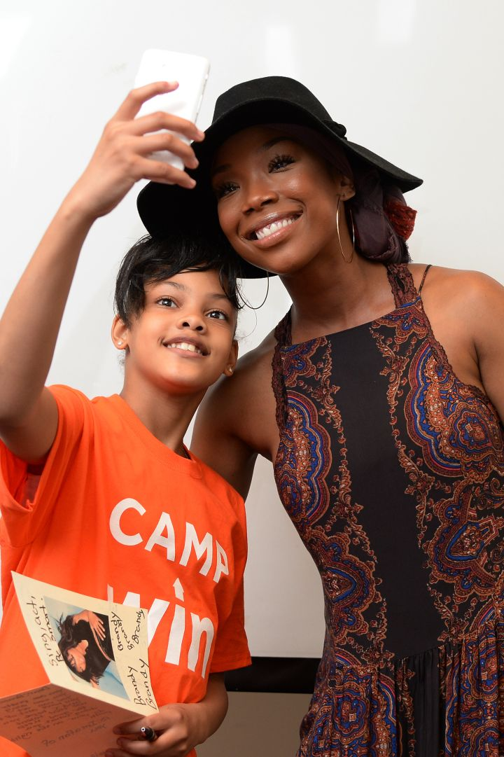 Brandy has a heart of gold. Here she is taking a selfie with one of the kids from the Precious Dreams Foundation. The Broadway star provided comfort items and motivational words to NYC Homeless Youth this week. What a way to give back.