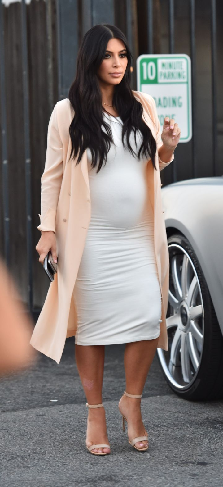 Kim's baby bump is on fleek in Beverly Hills. She's finally starting to show.