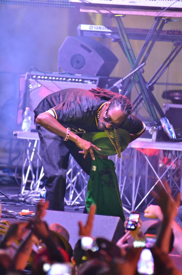 Uncle Snoop hit that get down low pose while performing in Naples at Arenile Beach.