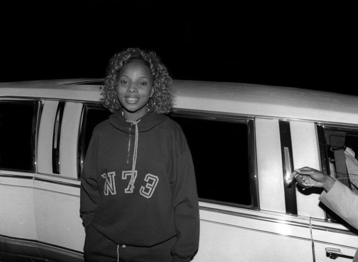 Mary J. Blige is all smiles in a hoodie and curls.