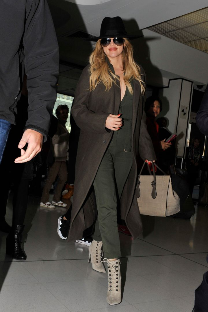 Khloe Kardashian rocked a green olive onesie while leaving Sydney.
