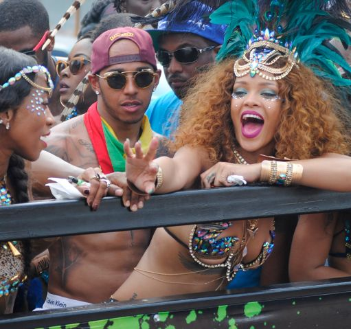 Rihanna and Lewis Hamilton are pictured partying during Barbados' Kadooment Day Parade