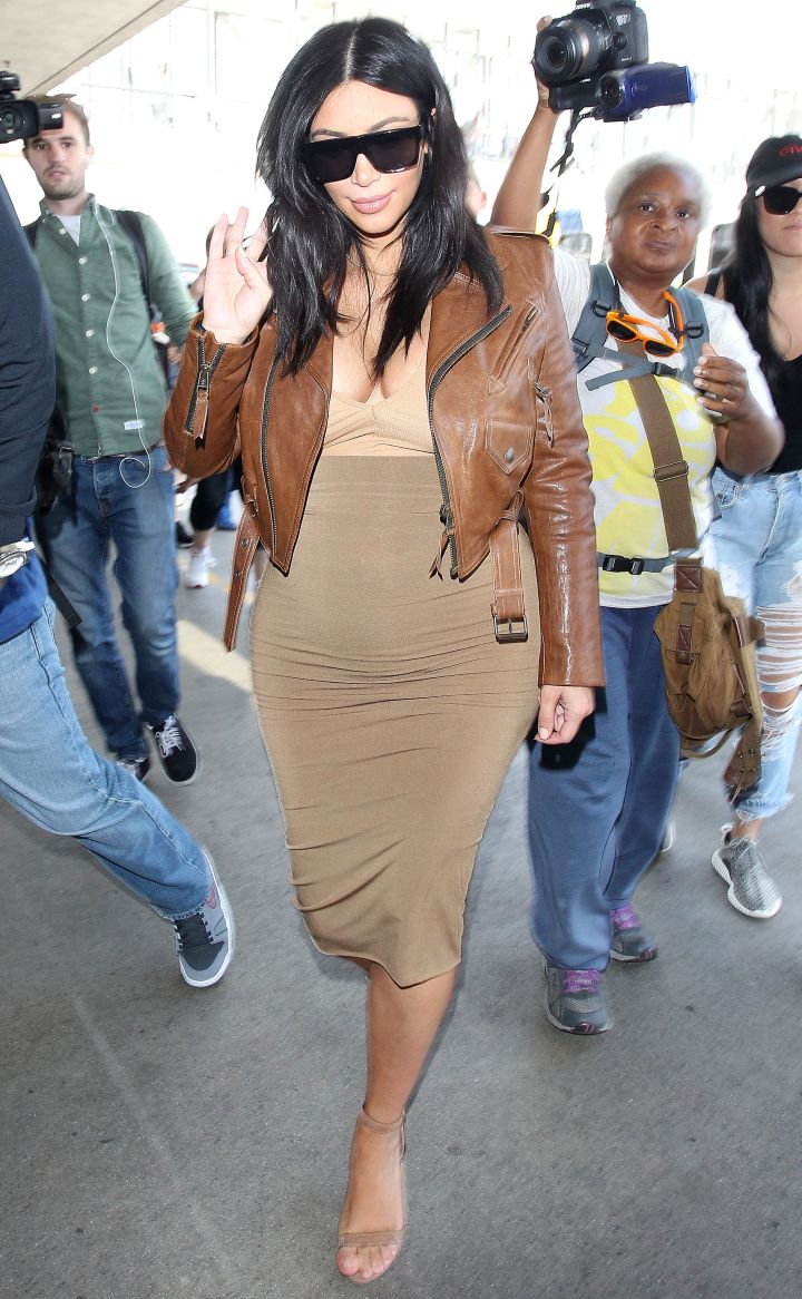Kim Kardashian was laced in leather before touching down in New Orleans with friends.