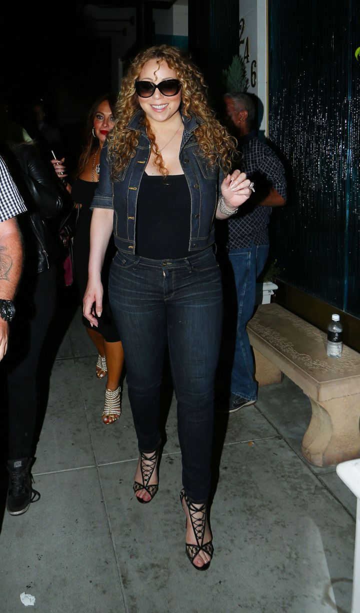 Mariah Carey dabbled in double denim for dinner with friends in Beverly Hills.