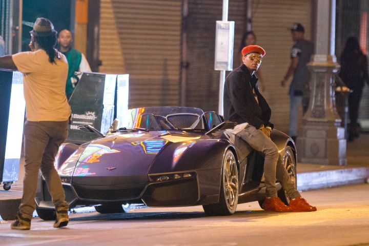 "Chris Brown shows off his brand new $165,000 Rezvani Beast supercar on set of the ""Liquor"" music video in Downtown Los Angeles."
