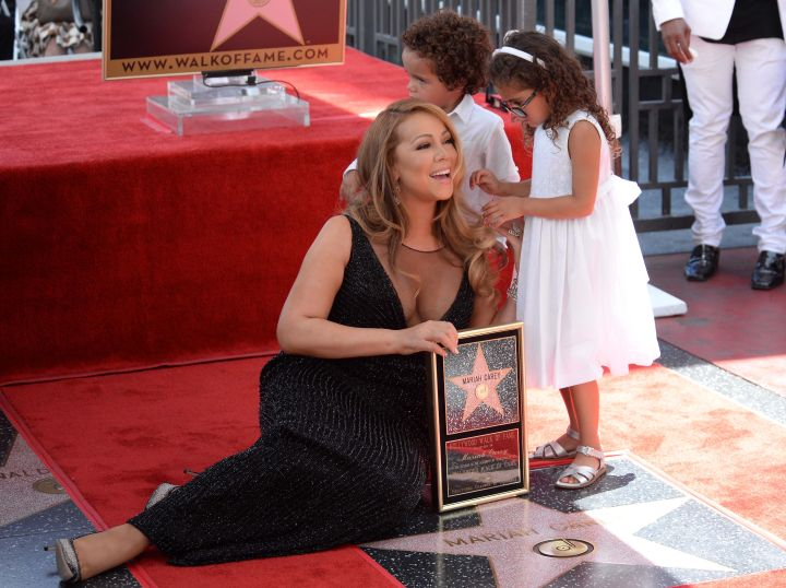 Mariah Carey's children Moroccan and Monroe Cannon get a bit restless as their mom received a star on the Hollywood Walk of Fame.