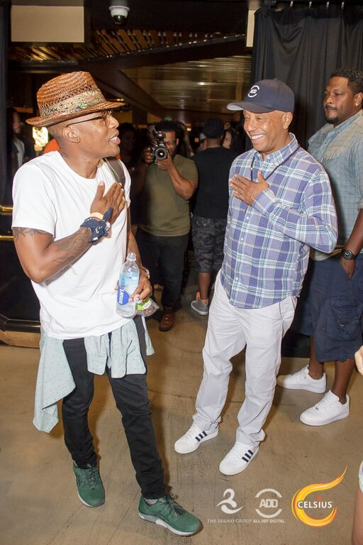Russell Simmons and Raphael Saadiq share a laugh.