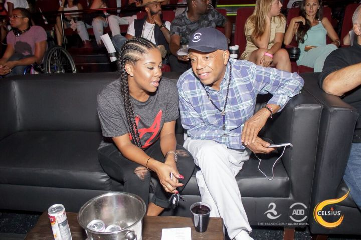 Russell Simmons and Miss Diddy take a second to catch up.