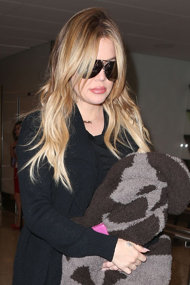Khloe kept it casual as she departed from LAX.