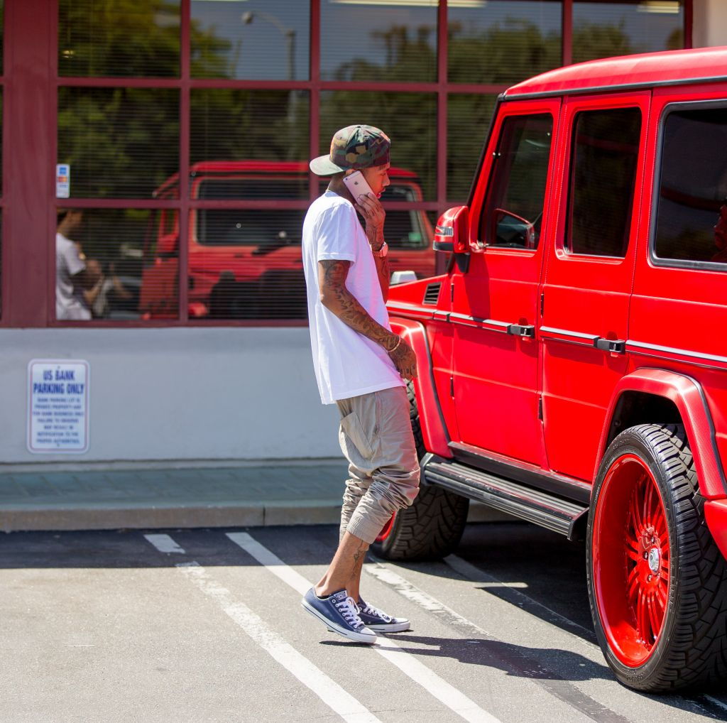 Tyga seen driving red Marcedes G Wagon to the bank in Calabasas, CA