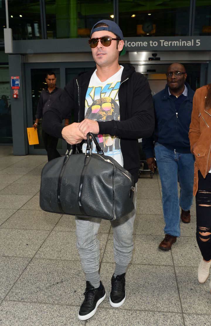 Zac Efron kept it casual while arriving at Heathrow Airport in London.