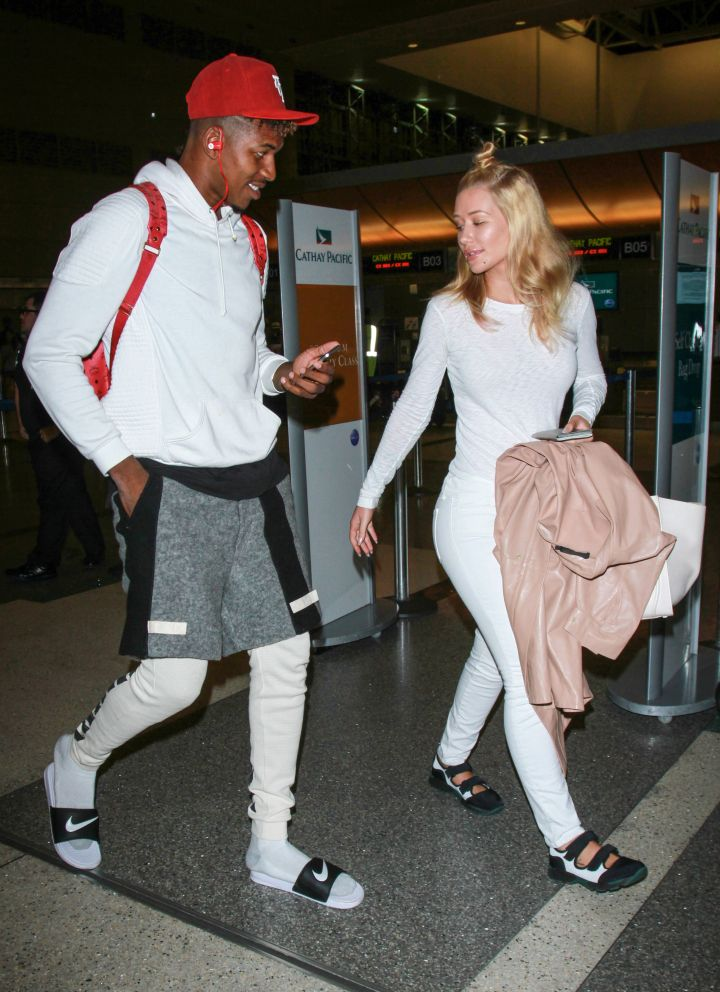 Nick Young and Iggy Azalea got lovey-dovey at LAX airport.