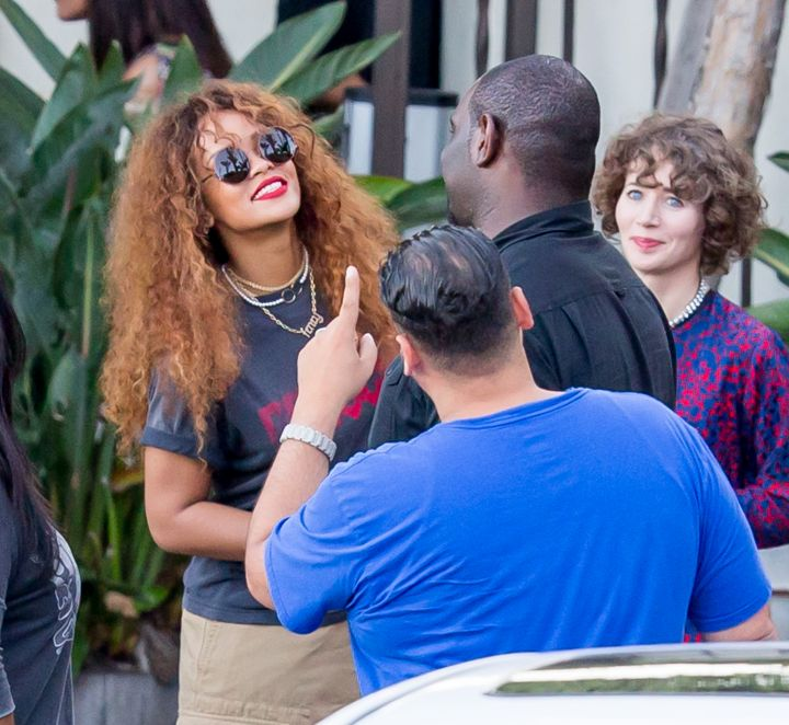 Rihanna was all smiles while taking selfies with fans.