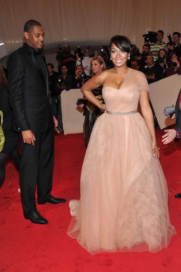 Melo admires his wife as she slays the red carpet.