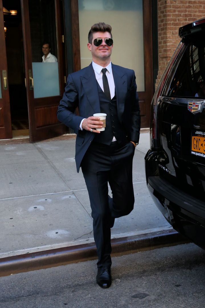 Robin Thicke looked happy as a clam as he left the Greenwich Hotel in NYC.