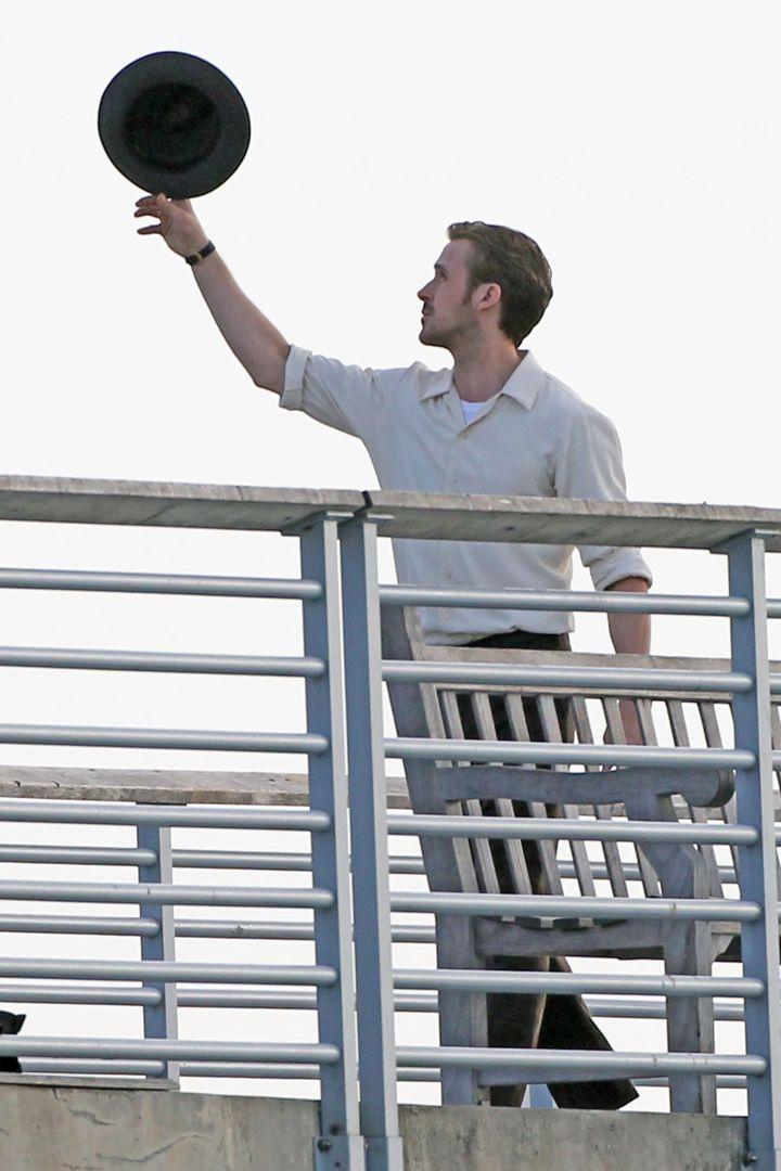 "Ryan Gosling pulls off a sick hat trick as he filmed a scene on a Los Angeles pier for his latest movie, ""La La Land."""