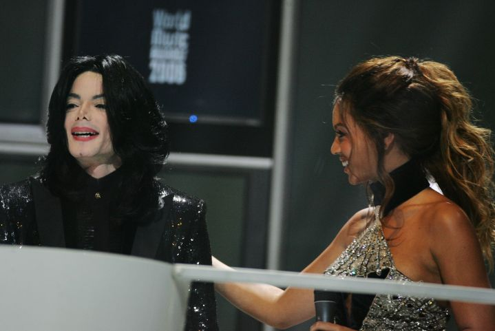 Receiving a World Music Award from Michael Jackson at just 25 years old.