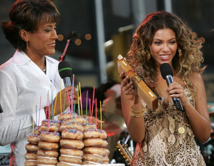 Beyonce and Robin Roberts share a laugh.