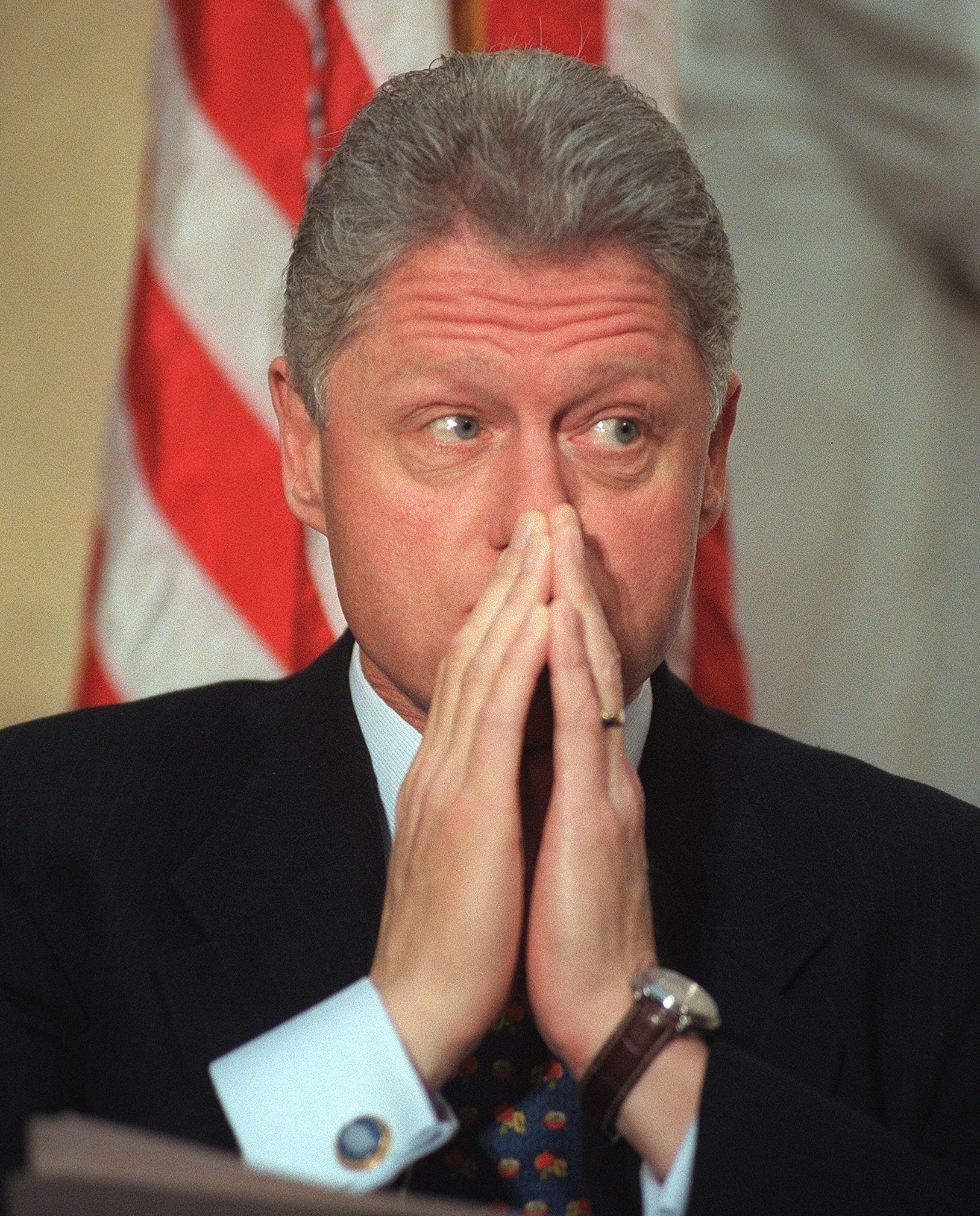 US President Bill Clinton listens during ceremonie