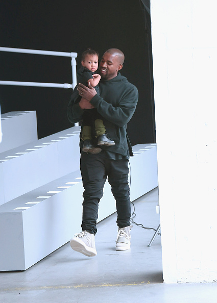 Twinsies! North and Kanye rock hoodies.