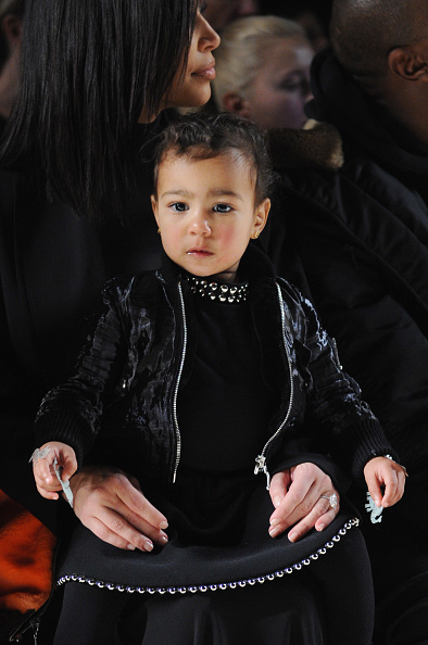 Front row at Fashion Week in all black everything, just like dad.